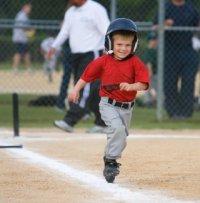 A happy t ball runner