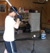 He loves to hit in our garage