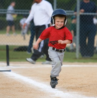 A happy t ball runner