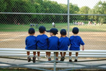 Players waiting for their kids t ball game to start